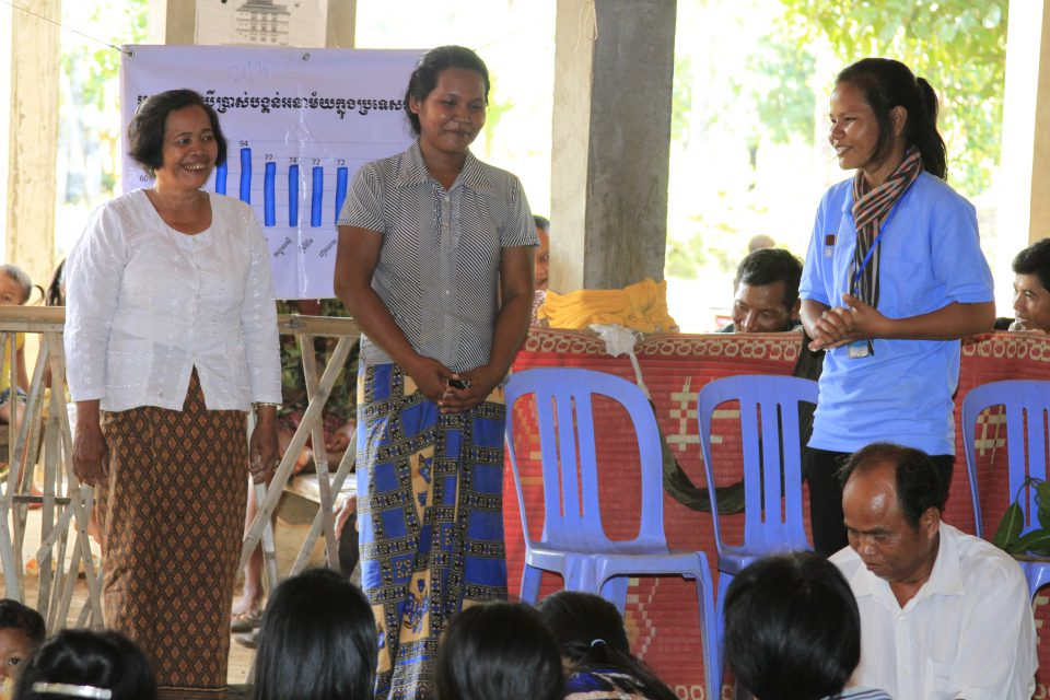 Villagers are listening to the presentation of their village chief acting as the sale agent during the sale event